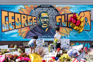 The George Floyd mural outside Cup Foods at Chicago Ave and E 38th St in Minneapolis, Minnesota on Thursday evening following a memorial service. The mural has become a popular spot to visit and to have a photo taken in front of it. | by Lorie Shaull