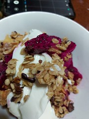 Breakfast is granola with whipped cream and dragon fruit