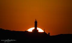 Sol tras Faro de Cabo Mayor