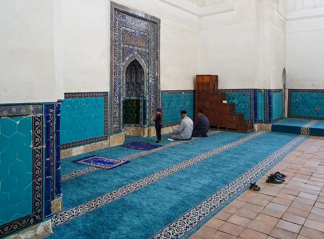 Praying in the mosque inside the mausoleumcomplex, Turkistan, Kazakhstan
