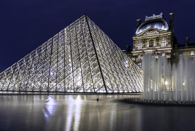 I M Pei Pyramid and Fountain at Night Paris France