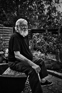 Old man relaxing in his garden...