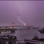 6. Juuni 2020 - 9:18 - Tokyo Rainbow bridge gets some extra light in thunderstorm tonight.   The unusual red illumination is to warn the citizens that Corona virus is still a danger and people should be careful.