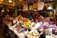 Pike Place market with flower vendor arranging flowers for sale