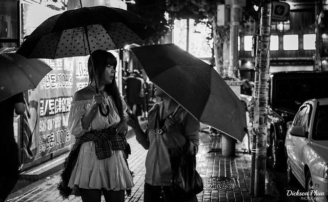 A conversation with umbrellas