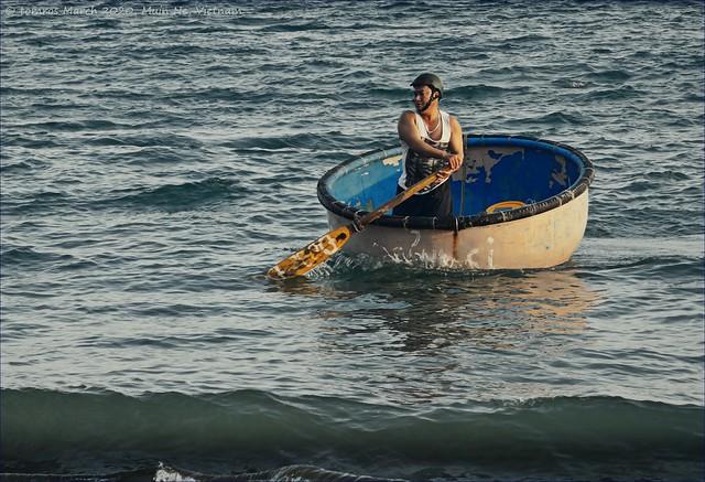 Basket case or Bath tub fisherman. Mui Ne, Vietnam.