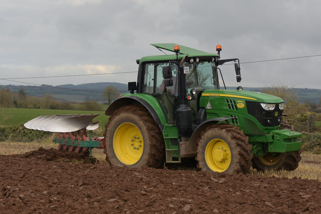 John Deere 6155M Tractor with a Kverneland 5 Furrow Plough