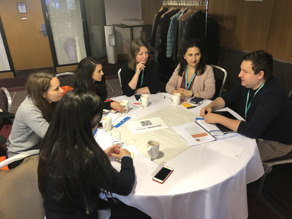 Youth@Work members sitting at a table having discussions