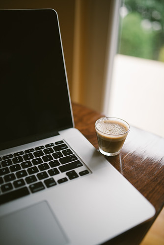 Laptop and coffee in the living room closeup. | by shixart1985