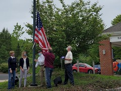 East Granby Public Library got a new flag courtesy of East Granby Veteran John Walker, who noticed that the old one was wearing at the ends. He took the initiative to purchase a new flag and donated it to the library. On Memorial Day, a small group met there, including Library Director Doreen Jacius, to raise the new flag.