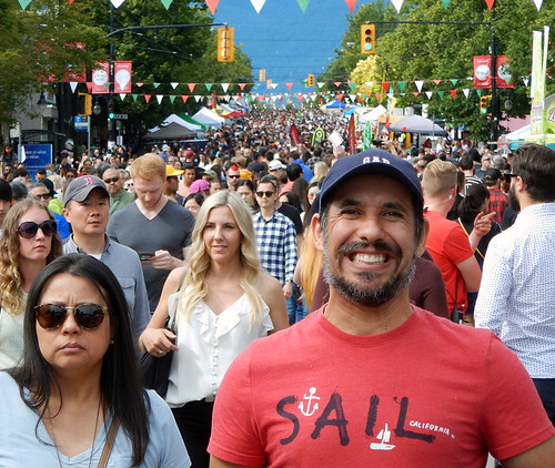 A smiling face in the crowd on Italian Day in June 2019, Vancouver, Canada