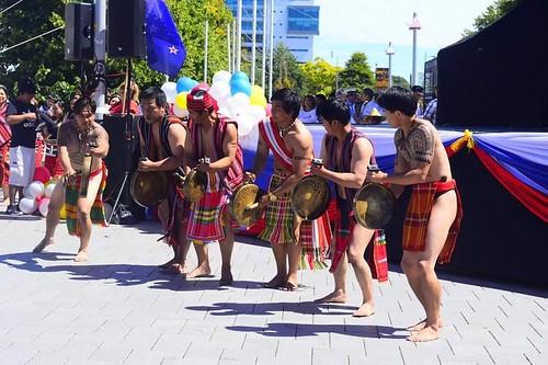 CAR NZ male dance group members beating gongs