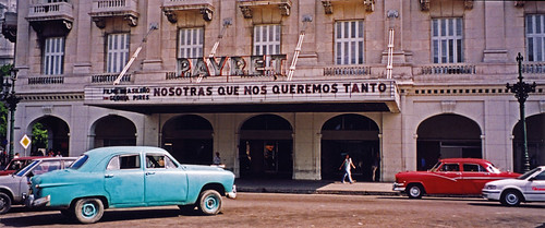 Old cars in front of the Cine in Havana, Cuba