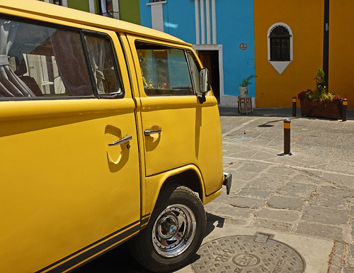 A yellow VW van fits right in with the brightly-coloured buildings of Puebla, Mexico