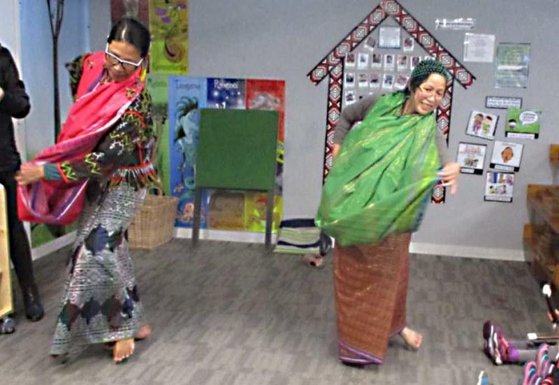 Supling facilitators perform a Filipino Dance