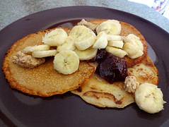 Yam flour pancakes with banana, peanut butter, and raspberry jam
