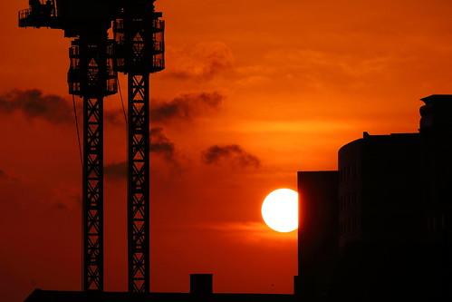 maihama chiba japan crane construction sunset sun cloud clouds sky