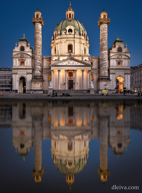 Karlskirche with illumination and reflection in the water, Vienna, Austria
