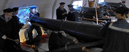 Mannequins in naval costume loading cannons