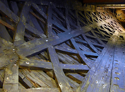 wood crossbeams in the hull of the boat