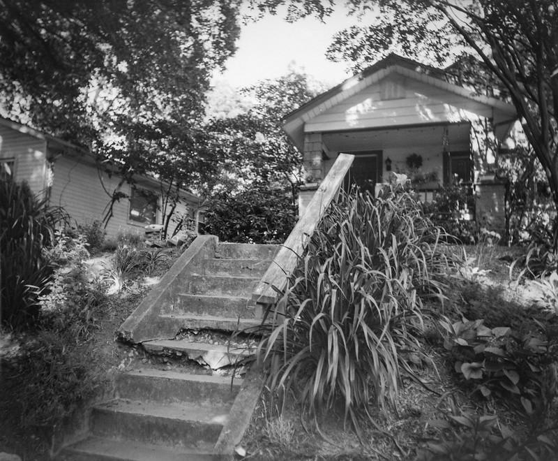 neighbor's front yard, crumbling steps, 1920s bungalow, Asheville, NC, Graflex Crown Graphic, Graflex Optar 90mm f/6.8, Arista.Edu 400, Moersch Eco film developer, 6.7.20