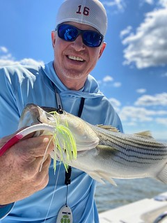 Photo of man holding a striped bass
