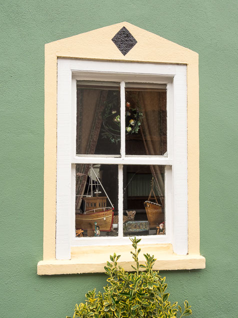 A traditional sash window of a Knsale shop