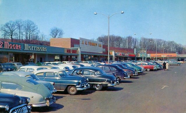 Welcome to the Amity Shopping Plaza! Eli Moore, Morrison's, J.C. Penny, Liggett Rexall Drugs and an enormous array of colorful 1940s and 1950s cars. Woodbridge Connecticut just north of New Haven. 1954
