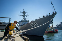 Boatswain's Mate Seaman Lucas Hood handles a mooring line as USS Kidd (DDG 100) departs San Diego, June 10. (U.S. Navy/MC2 Alex Corona)