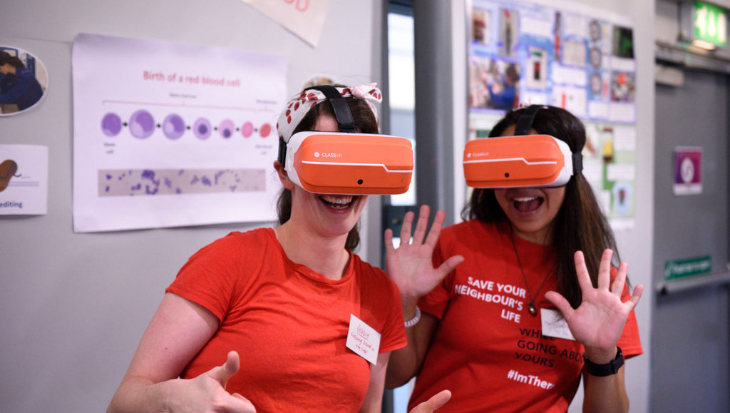 Two women wearing VR headsets