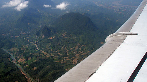 Flying over mountainous Laos to Siem Reap and Angkor Wat in Cambodia
