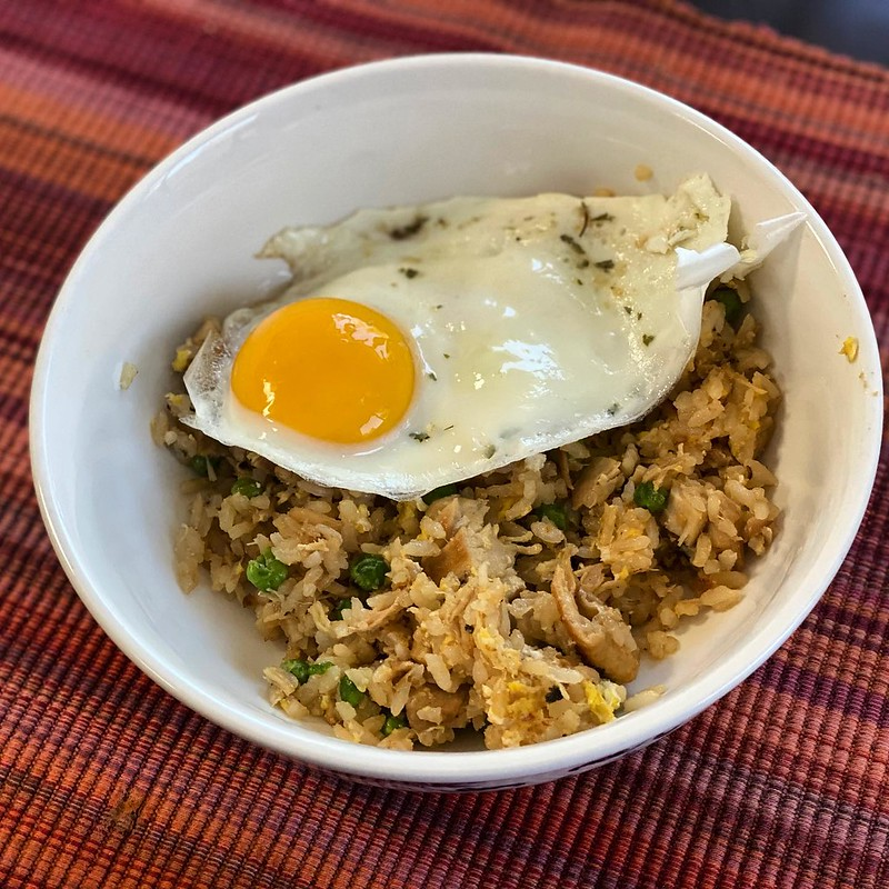 #kvpkitchen Adobe fried rice silog for lunch. I had pork adobo chilling in the freezer after one of my parents' visits. Warmed everything up. Then I fried rice with sesame oil, greens onions and peas. Mixed adobo and rice in the wok. Added a fried egg wit