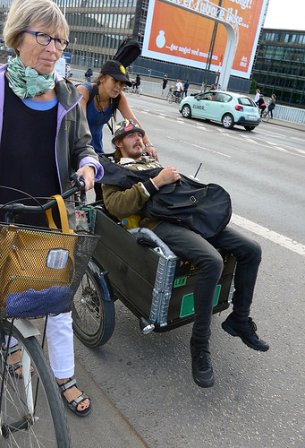 In Copenhagen, bicycles with carts out front are used for transporting all sorts of things, like these musicians on their way to a gig.
