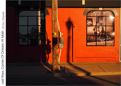 grimsby downtown store simplymoto building brick wall red redrule hardlight sunset shadows contrast windows telephonepole ontariostreet mainstreet opensource rawtherapee gimp olympus omdem5 mzuiko1442mmez13556
