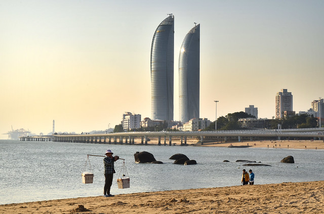 Baicheng beach and Xiamen skyline, China