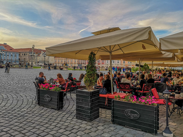 An outdoor restaurant on the city's square.