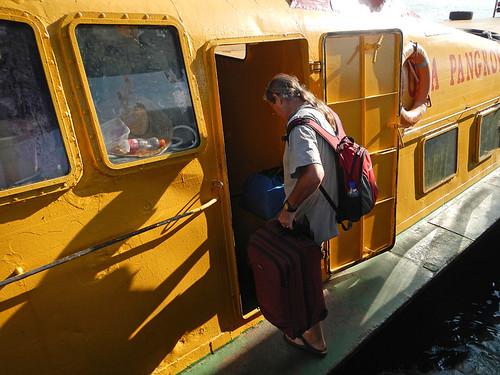 Boarding the yellow ferry at the jeti (dock) in Pangkor, Malaysia
