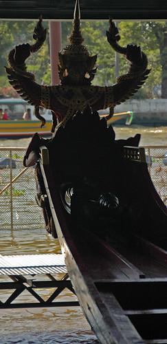 Figurehead as seen from the back on a long boat in the museum of the King's Barges in Bangkok, Thailand