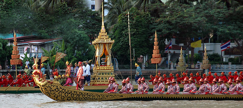 Boatmen, in traditional costume, rowing the King's Barges (long boats) in a rehearsal of the processions in Bangkok, Thailand