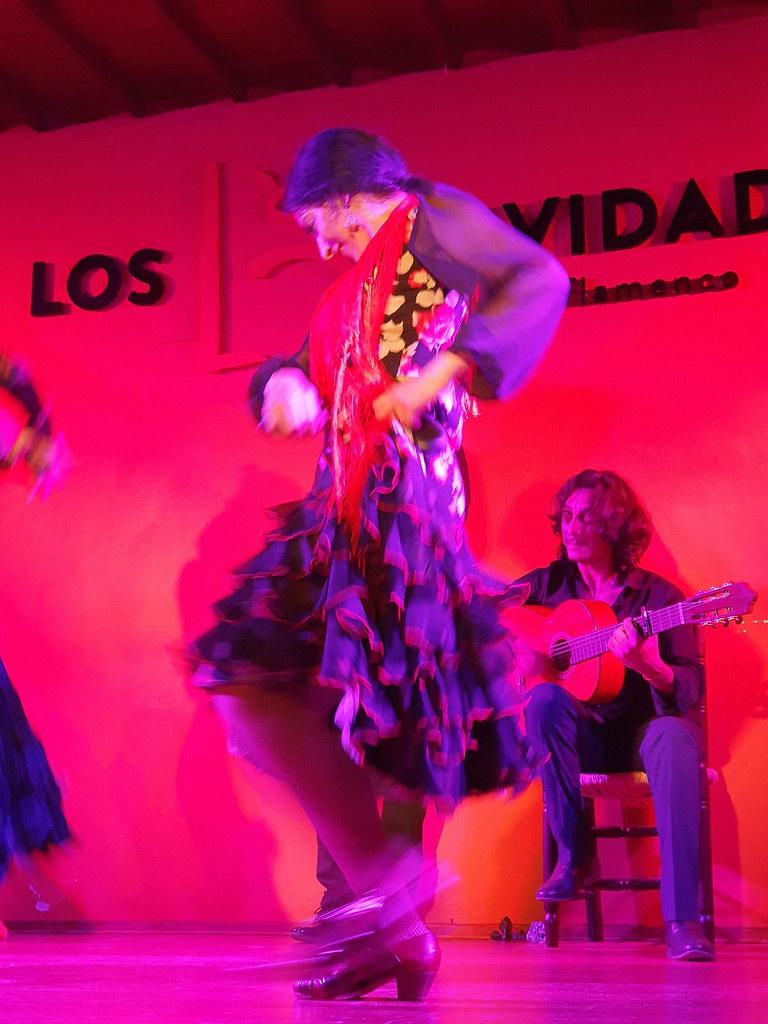 A blury picture of a flamenco dancer