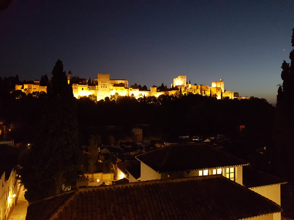 The Alhambra lit at night, seen from the gardens of Mirador de Morayma restaurant