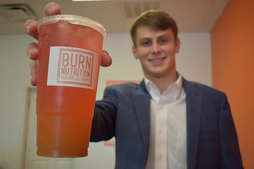 Brock Murphy holds a Burn Nutrition drink.