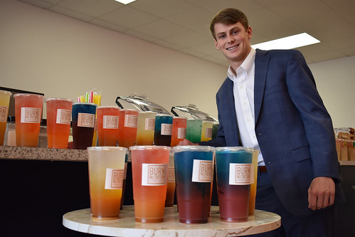 Brock Murphy stands behind a table with Burn Nutrition drinks.