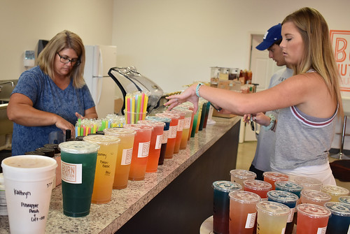 Employees at Burn Nutrition in Auburn prepare the supply of drinks.