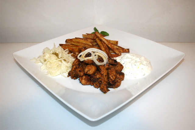 Turkey gyros with tzatziki, french fries & cole slaw - Side view - Served / Putengyros mit Tzatziki, Krautsalat & Pommes Frites - Seitenansicht - Serviert