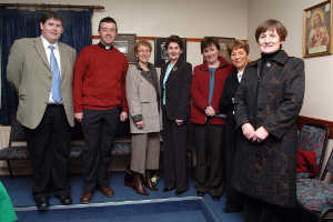 Among Women: Sean McKienan (Cavan County Council), Father Paul Casey, Brigid Duffy, Phyllis Finlay, Liz Hayden, Maureen Sheridan, and Madeline Argue (Cavan County Council) at the launch of the CYMS Website, on the 16th of February, 2006.