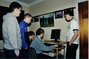 Lads standing around PC