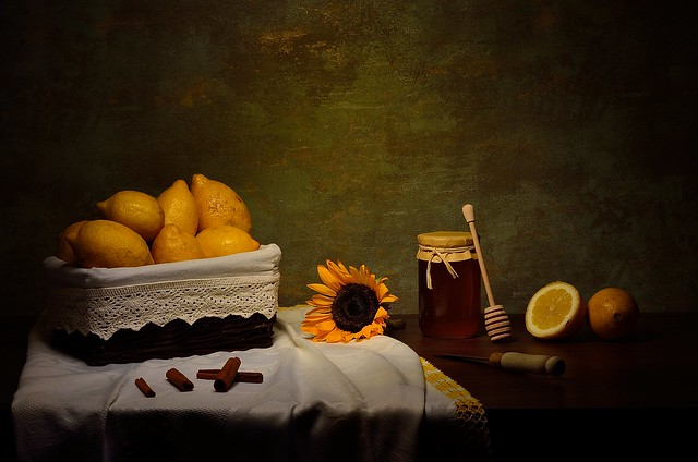 Still life with honey and lemons