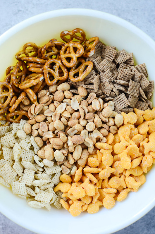 Cheesy Taco Chex Mix - Chex cereal, Goldfish crackers, pretzels, and peanuts tossed in a delicious taco seasoning and baked until crunchy and delicious!