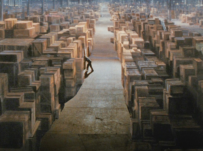 A large warehouse full of wooden crates.